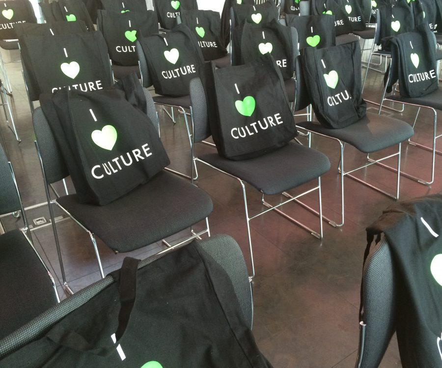 'I Love Culture' totes bags sitting on chairs. Naming ourselves CT Consults