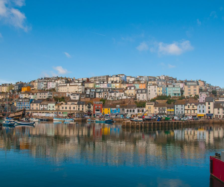 Colourful buildings on hillside, by fishing harbour
