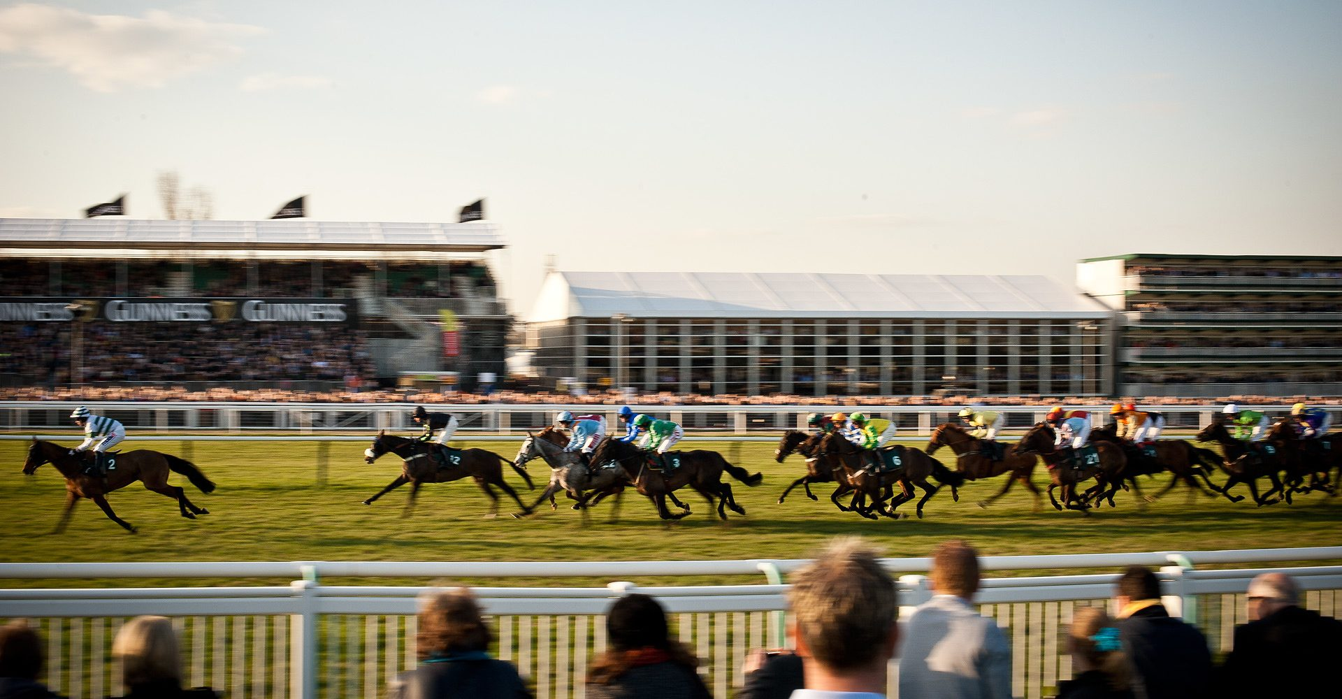 Horse race with crowds around the track and in stands