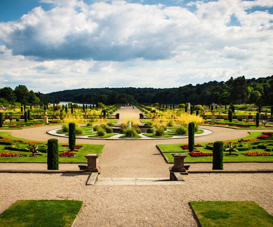 Formal garden with topiary and planted flower bed